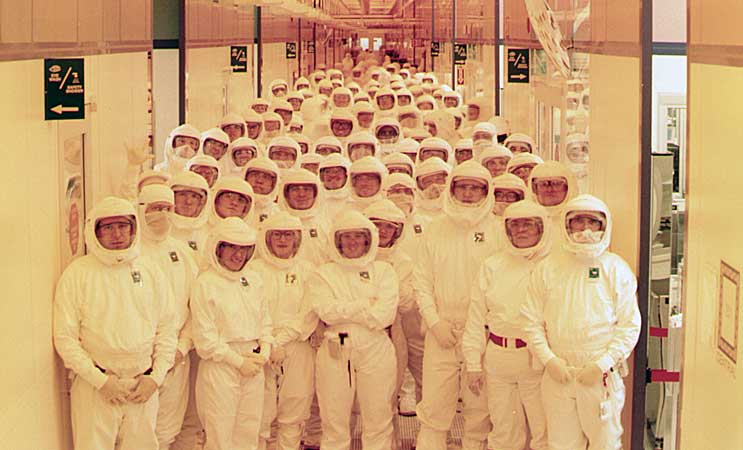 Intel workers in clean room bunny suits