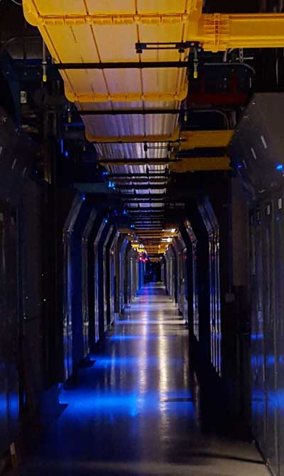 A long row of colocation cages inside the Equinix SV5 data center in San Jose, Calif. (Photo: Rich Miller)
