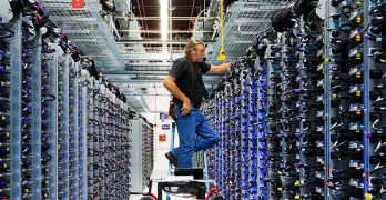 Google's Roger Harris performs maintenance on equipment in one of the company's data centers. (Photo: Google)