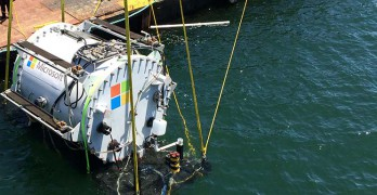 Microsoft's experimental underwater data center, the Leona Philpott, is lowered into the ocean in August 2015. (Photo: Microsoft Corp.)