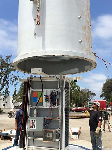 The Project Natick enclosure is lowered over a rack of Microsoft Azure cloud servers. (Photo: Microsoft Corp.)