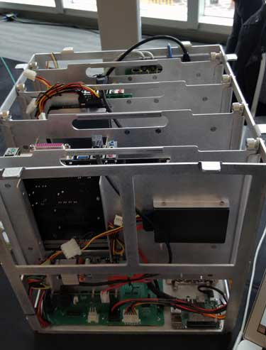 An overhead view of the guts of the RuggedPOD enclosure at the Open Compute Summit in San Jose, Calif. (Photo: Rich Miller)