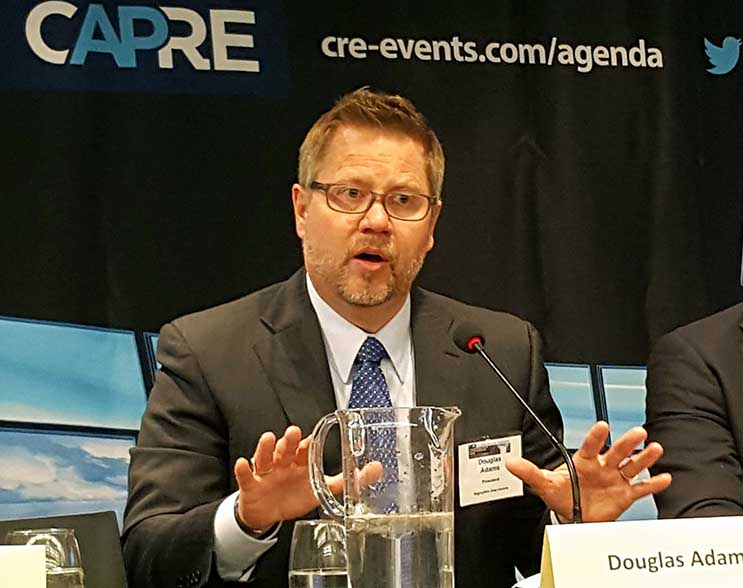 RagingWire CEO Douglas Adams speaks at a recent CAPRE data center summit. (Photo: Rich Miller)