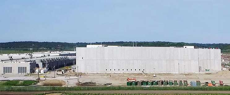 The new four-story data center at the Google campus in Council Bluffs, Iowa towers above the one and two-story data centers seen at left. (Photo: Google)