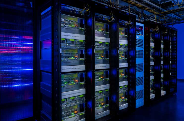 Racks packed with Big Sur servers inside the Facebook data center in Prineville, Ore. Each rack holds four of the GPU-accelerated chassis, which crunch data for artificial intelligence applications. (Photo: Facebook)