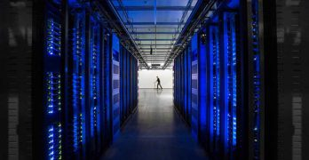 Rows of blue-lit server cabinets inside one of Facebook's data centers in Altoona, Iowa. (Photo: Facebook)