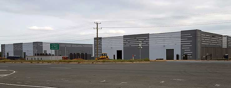 Two new data centers being built by Corporate Office Properties Trust (COPT) in Ashburn. The tenant is rumored to be Amazon Web Services. (Photo: Rich Miller)