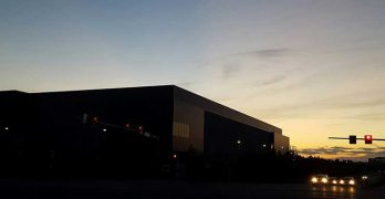 The sun sets over a new data center on the Digital Realty campus in Ashburn, Virginia. (Photo: Rich Miller)