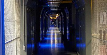 A corridor between the colocation cages inside the Equinix SV5 data center in San Jose, California. (Photo: Rich Miller)