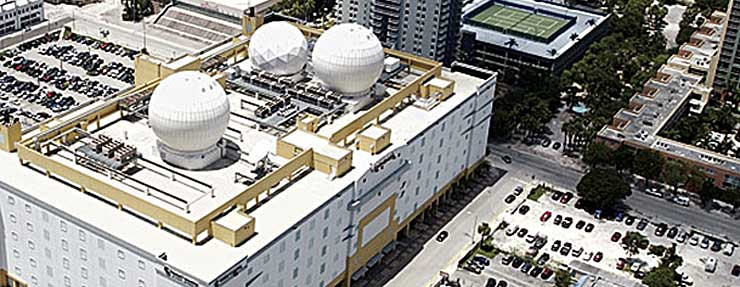 An aerial view of the NAP of the Americas. the massive 750,000 square foot interconenction hub in Miami. Equinix has acquired the building as part of a deal with Verizon. (Image: Verizon Enterprise)