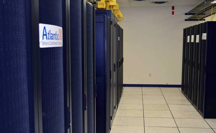 A row of cabinets inside the Fibre Centre data center, located atop a cable route through Moncton, Canada. (Photo: Fibre Centre)