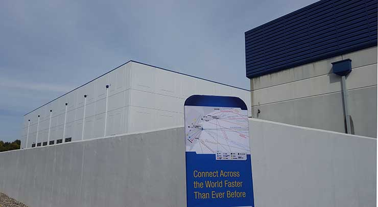 The new NJFX data center (at left) next to the Tata Communications undersea cable landing station in Wall Township, N.J. (Photo: Rich Miller)
