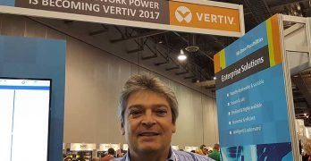 Enzo Greco, VP and General Manager of Data Center Solutions at Vertiv, with the company's new branding at the Gartner data center conference. (Photo: Rich Miller)