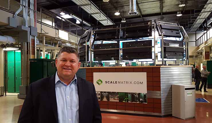 Chris Orlando, a co-founder of ScaleMatrix, in the company's San Diego data center and its distinctive central NOC. (Photo: Rich Miller)