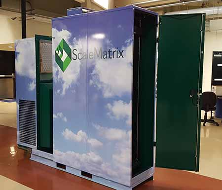 A ScaleMatrix DDC cabinet adapted for use in mobile deployments, with a chiller unit added that can slide out for maintenance. The unit can support 20kW of IT load. (Photo: Rich Miller)