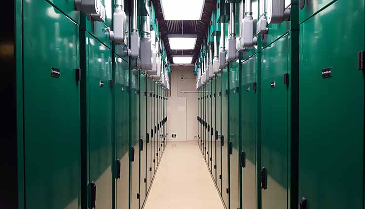 A row of Dynamic Density Control cabinets inside the ScaleMatrix data center in San Diego. The cabinets can support up to 52kW of power density, as well as armored cabling connections to protect network and water lines. (Photo: Rich Miller)