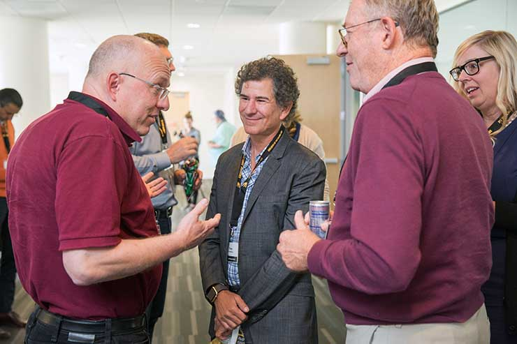 Christin Belady of Microsoft talks with RampRate's Tony Greenberg and Peter Gross of Bloom Energy. (Photo' Infrastructure Masons)