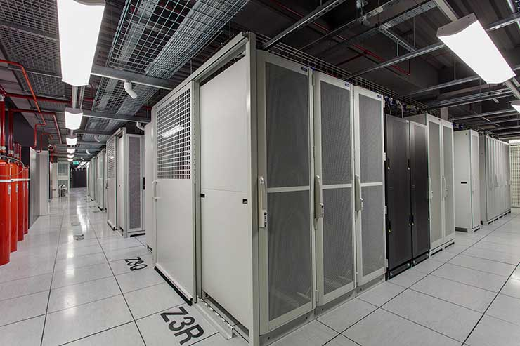 Cabinets and containment systems inside a a data hall in one of Cyxtera's London data centers. (Photo: Cyxtera)