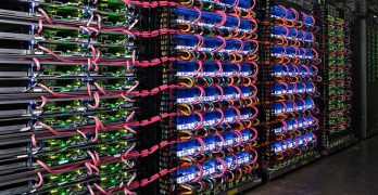 "A four-rack ""pod"" of Google Tensor Processing Units (TPUs) and supporting hardware inside a Google data center. (Photo: Google)"
