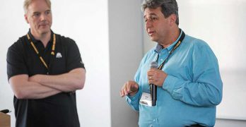 Open19 founder Yuval Bachar of LinkedIn (right) describes the project at last week's Infrastructure Masons Summit in Palo Alto, Calif. (Photo: Infrastructure Masons)