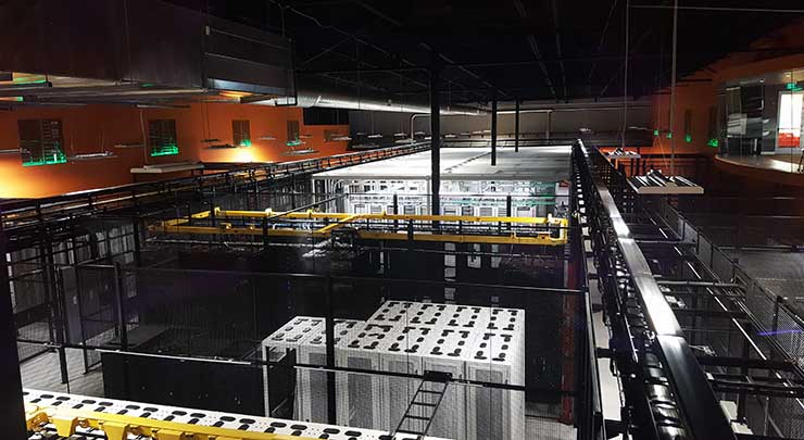 The view of the data hall from the overhead catwalk corridor at the RagingWire CA3 data center in Sacramento, Calif. (Photo; Rich Miller)