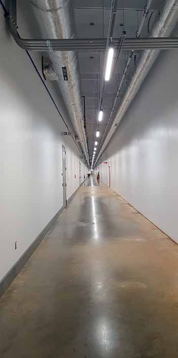 One of the long hallways inside the CloudHQ MCC1 data center. The building is 1,100 feet long, or about the size of a Nimitz class aircraft carrier. (Photo: Rich Miller)