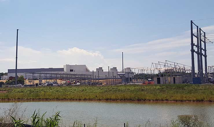 The exterior of the CloudHQ MCC1 data center in Manassas during the late stages of its construction and commissioning. At right is the massive Dominion Virginia Power substation that will support the campus. (Photo; Rich Miller)