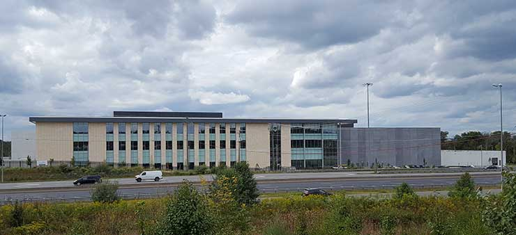 The CyrusOne Sterling V data center has a visible presence along Route 28 . (Photo: Rich Miller)