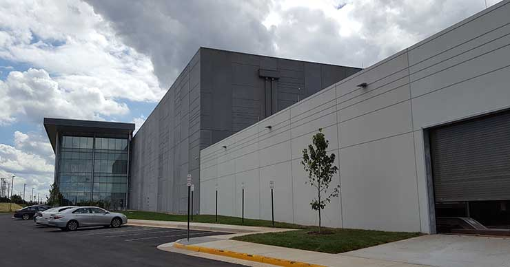 The front facade of Sterling V, showing the glass exterior on the three-story Class A office space. (Photo: RIch Miller)