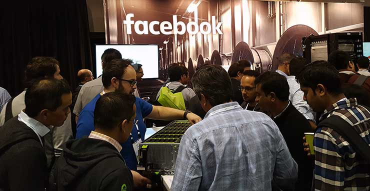 The expo hall offers a chance to see some cool new hardware. At this year's Open Compute Summit, a Facebook engineer shows off the company's Bryce Canyon storage unit on the show floor. (Photo: Rich Miller)