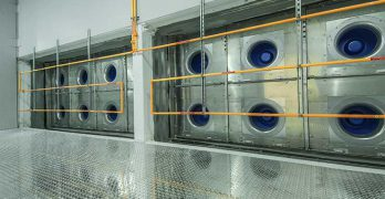 A fan wall inside the cooling plenum in a Compass Datacenters facility in Allen, Texas. The fans are fed by cool air from a Kyoto Cooling unit. (Image: Compass Datacenters)