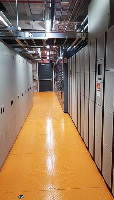 Inside one of the color-coded power rooms inside the TierPoint data center in Allen, Texas. (Photo; Rich Miller)
