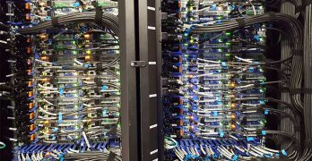 Some of the network cabling for the Comet supercomputer at the San Diego Supercomputer Center, viewed from the hot aisle. (Photo: Rich Miller)