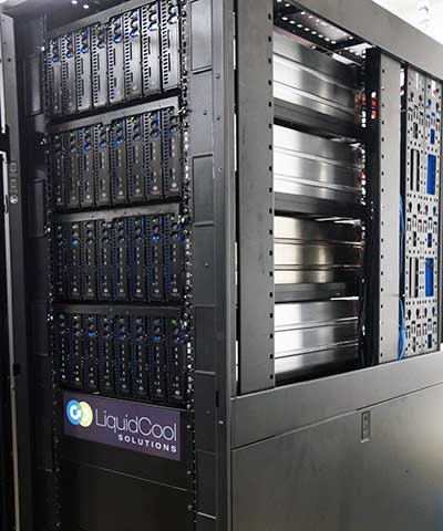 The front view of a rack of servers using the LiquidCool immersion cooling system, with a side view of the sealed cases that house the components and dielectric cooling fluid. (Photo: LiquidCool Solutions)