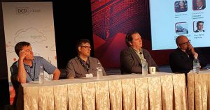 Panelists at DCD Edge contemplate the cost of edge computing. From left: Chris Crosby, CEO of Compass Datacenters; Eddie Schutter of DCFD Technologies; Ty Schmitt of Dell EMC; and George Slessman, CEO of IO. (Photo: Rich Miller)