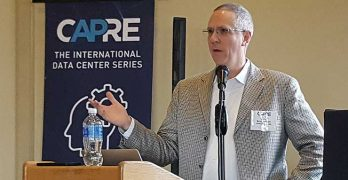 Allen Tucker of JLL gives the keynote presentation at Wednesday's CAPRE 2018 Data Center Forecast in Ashburn, Virginia. (Photo: Rich Miller)