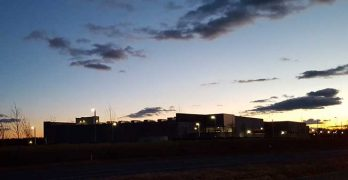 The sun sets behind Building L, the massive new Digital Realty data center in Ashburn, Virginia. (Photo: Rich Miller)