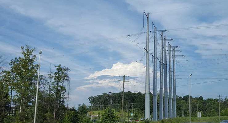 High-capacity power lines in Manassas , support data center development in Prince William County. ( Photo: Rich Miller)