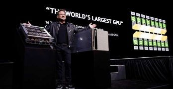 NVIDIA founder and CEO Jensen Huang shows off new hardware for the DGX-2, the upgraded version of the company's desktop supercomputer. (Photo: NVIDIA Corp.)