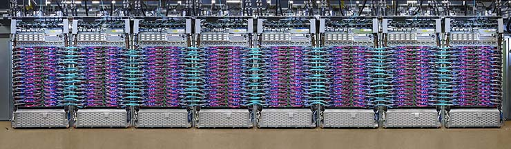 A Google TPUv3 system, which sonsists of eight racks of liquid-cooled devices featuring Google's custom ASIC chips for machine learning. Click the image to see a larger version. (Image: Google)