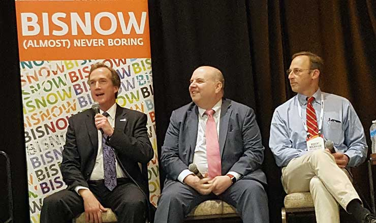 Jim Leach of RagingWire make a point during last week's BisNow Data Center Investment Conference in Tysons Corener, Va. Listening on are Loudoun County's Buddy Rizer, and Rob Rockwood of Sabey Data Centers. (Photo: Rich Miller)