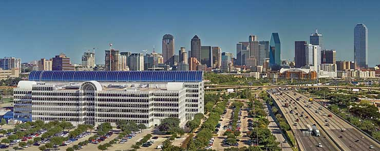 The Equinix Infomart, with the Dallas skyline behind it. (Photo: Equinix).