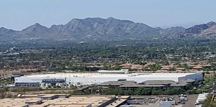 An aerial view of Iron Mountain's Phoenix data center, against the backdrop of nearby mountains. (Photo: Rich Miller)