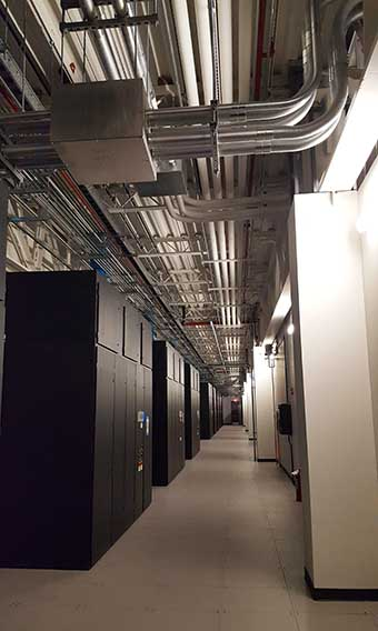 A cooling equipment corridor in the QTS Ashburn data center. (Photo: Rich Miller)