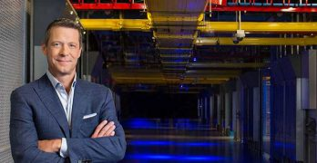 Equinix CEO Charles Meyers in one of the company's familiar blue-lit data centers. (Photo: Equinix)
