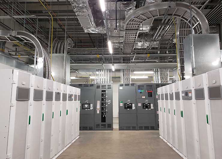 The power room in the QTS Manassas data center, including Schneider Galaxy VX UPS units (white cabinets) supported by Li-ION lithium-ion batteries. (Photo: Rich Miller)