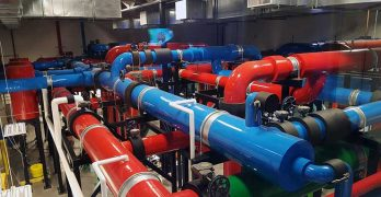 Massive color-coded pipes move water to and from the cooling equipment plant at the NTT Global Data Centers Americas campus in Sacramento, Calif. (Photo: RIch Miller)