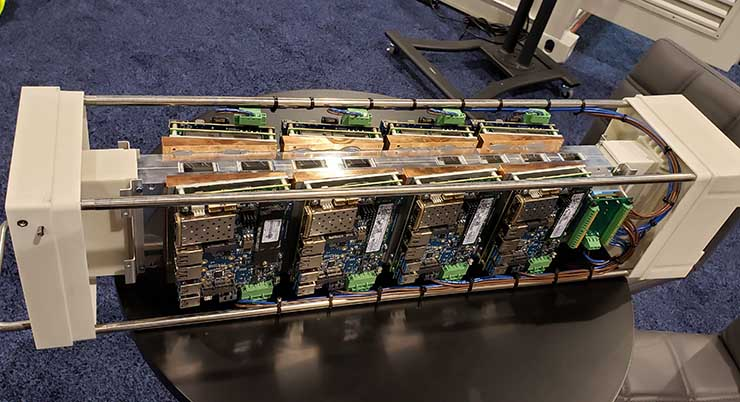 A server assembly with servers attached to both sides of the Forced Physics JouleForce Conductor cooling unit. This unit was on display on the expo floor at Data Center World in Phoenix. (Photo: Rich Miller)