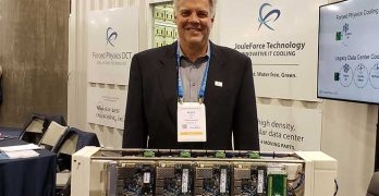 Forced Physics CEO and founder Scott Davis with a server assembly with servers attached to both sides of the Forced Physics JouleForce Conductor cooling unit. (Photo: Rich Miller)