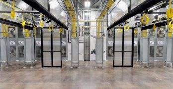 A data hall in an Aligned Energy data center in Dallas, ready for racks. The rear wall of the hall features Aligned's Delta 3 cooling system. (Photo: Aligned Energy)